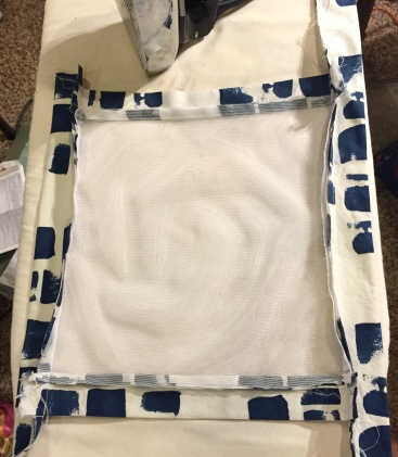 I sew the top and bottom strips on first, then add the side strips.